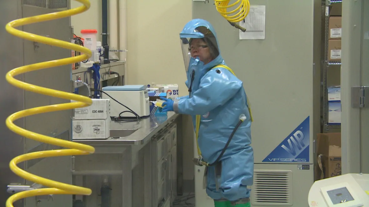 Xiangguo Qiu works in level-4 containment at the National Microbiology Laboratory in Winnipeg.